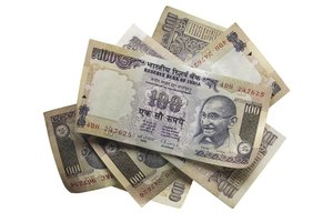 Some vendors in India won't accept badly worn or ripped rupees.