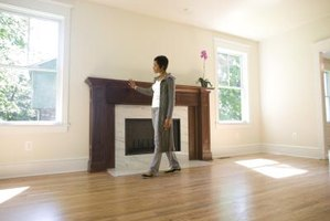 Wood floors around a fireplace make the living space warm and inviting.
