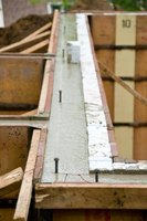 Some sill plates are attached to bolts embedded in wet concrete; others are drilled.