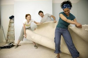 Cut old carpeting into strips to making removal easier.