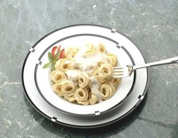 Cooking pasta in milk reduces the need for cream or half and half.