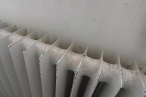 Paint and rust can keep epoxy from sealing a cracked radiator properly.