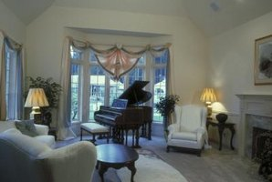 The piano in this room draws attention to a large bay window.