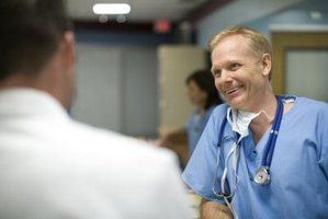 Smiling health care worker talking to coworker in hospital.