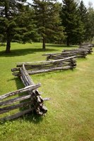 Stacked split-rail fences offer an old fashioned building material in areas with trees.