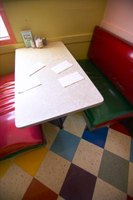 Restaurant booths often have upholstered bench seat backs attached to the walls.
