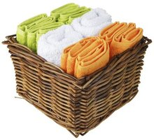 A basket is a storage option for towels.
