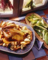 A whole roast chicken with vegetables is only one of many recipes you can make with your Pampered Chef Deep Covered Baker.