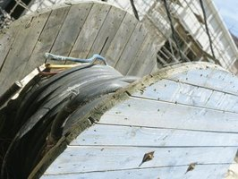 Discarded cable spools are the raw materials for garden chairs.