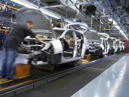 Cars and car parts are manufactered on assembly lines at General Motors Plants.