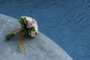 Wedding bouquet next to a swimming pool.