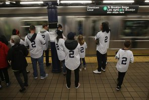Yankee fans take the subway to the stadium.