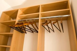 Add a wooden wardrobe to make another closet in the bedroom.