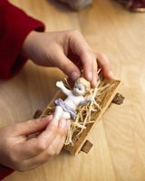 In a nativity set, the baby Jesus rests in a manger.