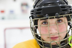 Young hockey player wearing a helmet.