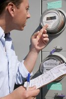 Utility company representatives read electric meters to calculate customer charges.