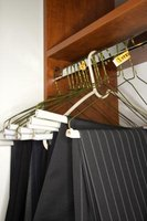 Get rid of metal and plastic hangers. Organize with a wooden rack.