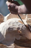 Use a chisel and wood-carving knife to hand carve wood.