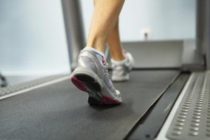 Woman's feet walking on an indoor treadmill.