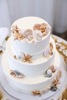 Let the seashells add the sea theme to a plain cake, or make the cake in an ocean-inspired shape and add the shells.