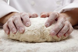Knead the dough by hand on a flat, floured work surface until the dough is smooth and stretchy.