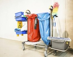 A custodian's cart holding cleaning supplies.