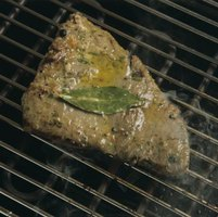 Cooking tuna steaks quickly over high heat sears the outside surfaces.