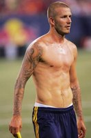 David Beckham displays a flat stomach with developed abs.
