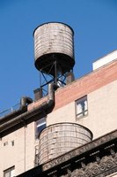 Water towers are not just for rural areas and can be seen on top of builings in urban areas.