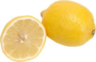 Sliced lemons will give a centerpiece a vibrant look.