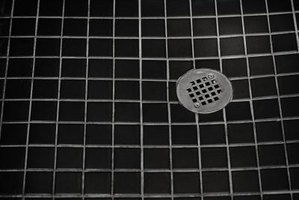 shower drains need to be flush with the tile