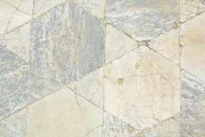 Floor tile damage can be caused by dips in the subfloor.