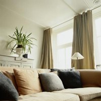 Add interest to windows by installing drapery sconces.