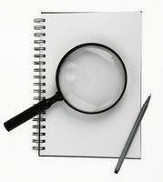 Using a magnifying glass can help identify the subtle hints that a print may be an engraving.