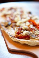 Experiment with different flavor profiles on your homemade pizza.