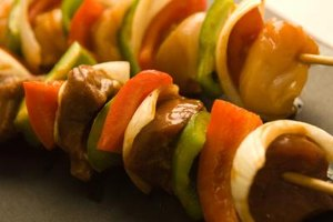 Marinate the meat and add sliced vegetables to the kabobs for a complete, flavorful meal.