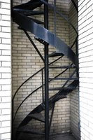 Metal, open-riser spiral staircases are dangerous for children.
