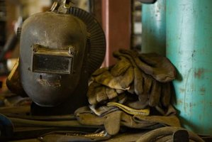You should wear a welding mask and gloves to protect from UV rays and molten metal.