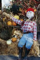 Sitting scarecrows are often seen as decorations at pumpkin patches in the Fall.