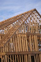 Beams, like the beams that support the second story of this house, may be built or manufactured.