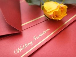 Carefully wording wedding invitations makes listing a deceased parent acceptable.