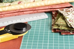 Rotary cutters and acrylic rulers make measuring and cutting quilt pieces easier.
