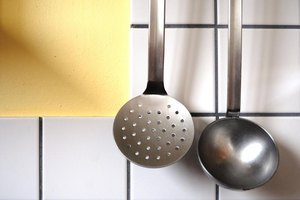 Slotted spoon hanging in the kitchen.