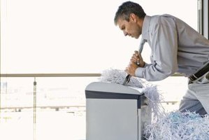 A tie clip can prevent a man from getting his tie stuck in the paper shredder at work.