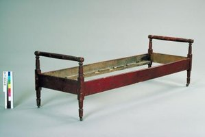 Antique beds typically accommodate a double mattress.