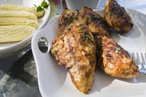 Working a dry rub onto chicken can make a flavorful entree.