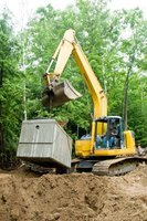 Heavy construction machinery is required to install a septic tank.