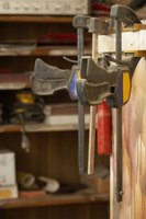 Use woodworker's clamps to glue plywood together.