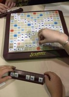Scrabble for the iPad allows you to use iPhones as letter racks.