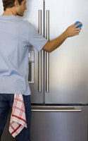 Start cleaning your refrigerator from the outside and work your way inside.